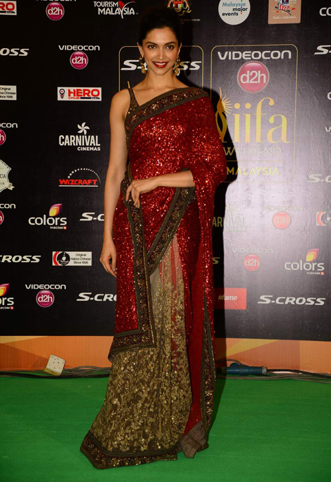 Deepika shine in red Sabyasachi sari with red lips
