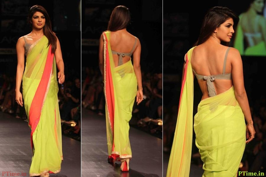 a lime green fancy saree in net with an orange border, designed by Manish Malhotra